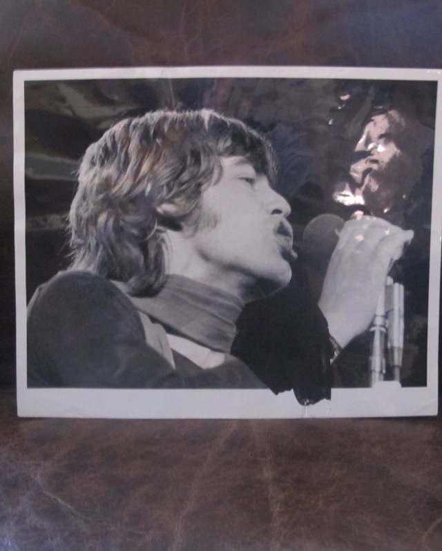 MICK'S MUG: Original wire photo close-up of Jagger on-stage, 1969 tour. From the