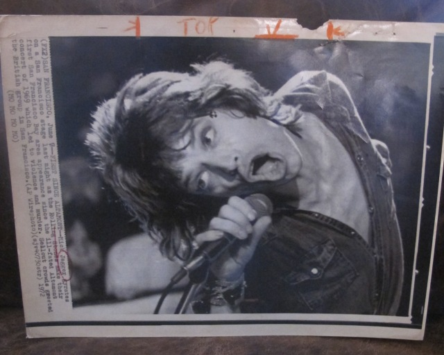 JAGGER GYMNASTICS: Utilizing the skills he learned as a boy guesting/helping on his dad's physical fitness program in the '50s -- yes, true! -- Mick does some acrobatic moves of his own on the '72 tour. Original wire press photo from the