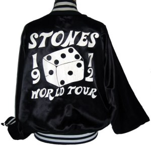 "This is my Jagger-designed silk tour jacket specially given out only to the band and road crew/tour members during the 1972 tour in support of ""Exile On Main St.""  The striking black and white color combo was picked so the members of the Stones Touring Party could be easily spotted in any arena or venue. Of course, this stuff (and the attendant merchandising) is routine now, but this jacket was a predecessor for the major rock tour gear of the 1970s and beyond. Not available to the public, and one of the gems of my Stones collection. It was there, even if I was not."