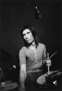 WATTS THE TUNE? Stones drummer Charlie Watts sweats to the beat in the basement at Nellcote, 1971.