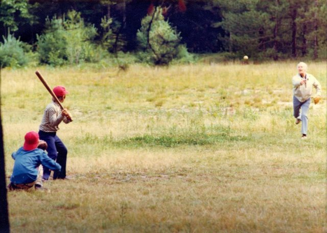 My dad throws batting practice to my brother Chris (batting) and me (catching) one of countless times we played until dusk forced us inside, circa 1976-77.