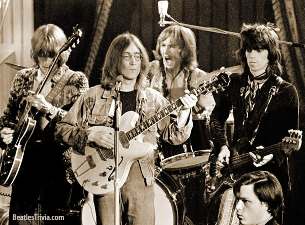 "The Dirty Mac belt out ""Yer Blues"" at the Rolling Stones Rock & Roll Circus, 1968. Photo credit: Don McCullin"