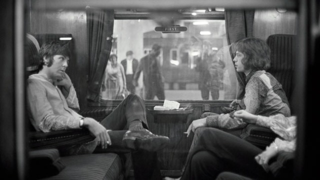"""First Class Travel"": McCartney and Mick wonder who will be England's richest rock star. Photo credit: Victor Blackman/Express/Getty Images"