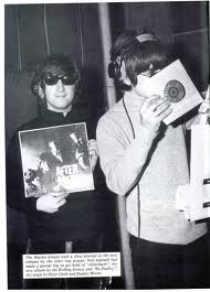 "The Beatles' John Lennon and Paul McCartney check out the Rolling Stones' latest, ""Aftermath,"" in 1966, which came hot on the heels of the Beatles' ""Rubber Soul."" They'd follow it up with ""Revolver."""