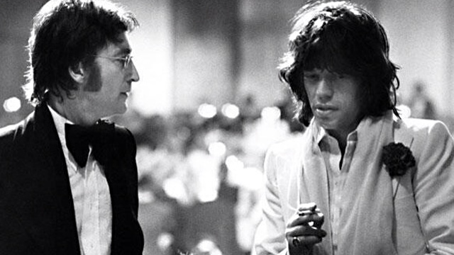 "The Dirty Mac reforming? Or John and Mick strategizing the session for ""Too Many Cooks"" (an intended and ultimately aborted Jagger solo single that finally saw official release on a Jagger solo compilation, ""The Very Best of Mick Jagger,"" decades after its 1973-74 recording)."