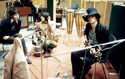 "Sympathy for Helter Skelter: Hearing congas and possibly Keith Richards's finest guitar solo ever, Paul McCartney drops by Olympic Studios during the making of ""Beggars Banquet,"" 1968."
