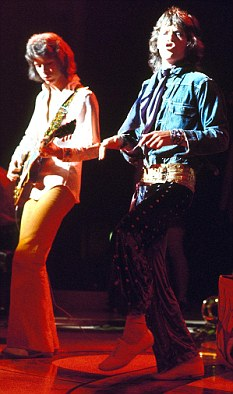 Licks 'N' LIPS: The two Micks on stage, '72. Credit: Photo by GLOBE PHOTOS / Rex Features ( 42336a ) ROLLING STONES, MICK JAGGER, MICK TAYLOR VARIOUS - 1972