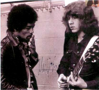 Taking pointers? Mick Taylor and some guy named Jimi hang backstage at Madison square Garden at the Stones show, 1969.