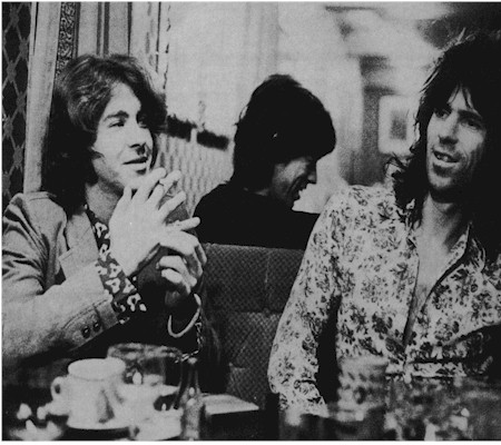Did ya hear the one about the farmer's daughter? The two Micks and keith share a laugh and a light moment over breakfast on the road, 1973.