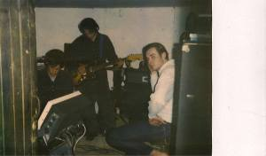 MAKING MEDEIROS: A rare glimpse of Wheat at work, half-lit like their music, in the  shadows, circa '96