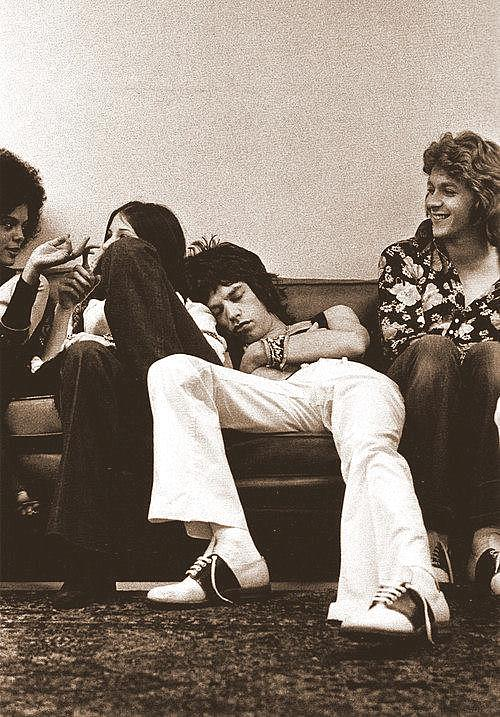 STRAY CAT NAP: 40-wink Mick catching some quick Z's with the Stones backstage between shows, somewhere along the road, 1972.