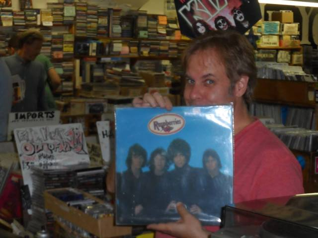 "Me hiding the pain of encountering Mason's glare of betryal yet again while persuing the ""R""s of my local record store, ""In Your Ear!"" On the upside, I found this tasty scratch-and-sniff pressing of this Raspberries debut LP!"