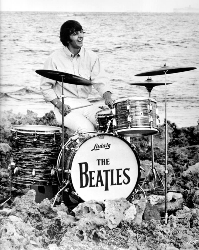 Ringo auditions for the Beach Boys and hopes that ocean mist doesn't warp the skins (no, not really, silly...on set for