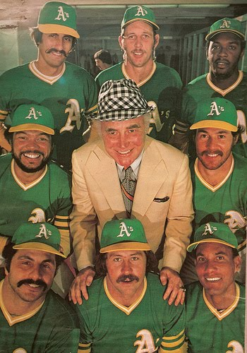 Oakland A's owner Charlie O. Finley likely told his '74 squad he'll have Farrah Fawcett-Majors give them a Noxema shave if they smiled for the camera and pretended to like him.