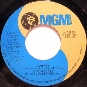 """Convoy"" singer C.W. McCall not only wasn't a real trucker, he wasn't even a real person! The Southern drawling CB-smack talkin' truck driver who ""crashed those gates doin' 98"" belonged to advertising executive Bill Fires. Nobody cared, and the novelty single shot up the charts and started a few convoys of its own at the Woolco checkout line."