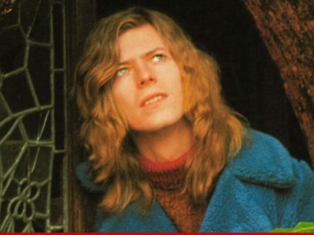 Everything Hunky Dory up there? Bowie looks to the sky to see if Major Tom is still floating in space with his protein pills.