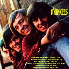The Monkees debut LP, 1966: For years I thought the boys were leaning over an arched bridge. Then I saw the complete photo somewhere, which showed this bridge to actually be Davy's tweed-pants-ed leg!