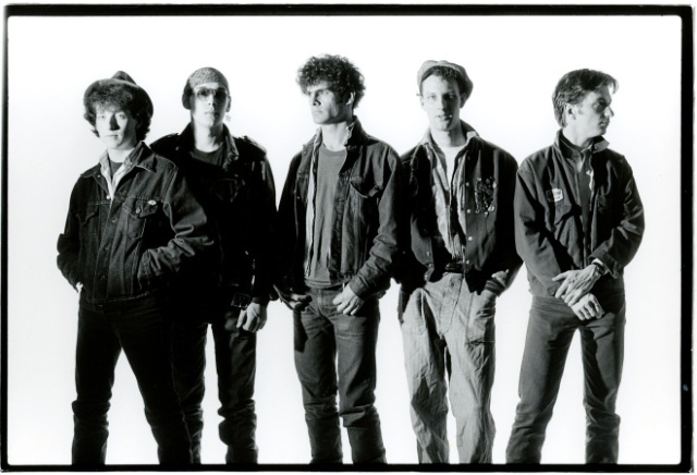 Studio portrait of Boston roots-rock band Scruffy The Cat. L to R: Mac Paul Stanfield (bass), Randall Lee Gibson (drums), Stephen Fredette (guitar), Charlie Chesterman (guitar/vocals), Stona Fitch (banjo, organ, accordion)