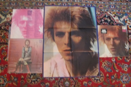 "Original poster that came enclosed with early reissue copies of ""Space Oddity"" (originally released in 1969), plus inner record jacket with lyrics and front and back cover"