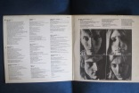 Rare variation of printed gatefold inner with phots and lyrics found on the German version of Ziggy