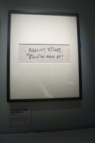 "Mick jagger's hand-written title for ""Exile"" dashed off in black marker, as per Robert Frank's suggestion"