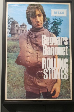 "Ultr-rare promotional ad image for ""Beggars Banquet."" Why is Charlie missing an arm? Perhaps he is begging for it back?"