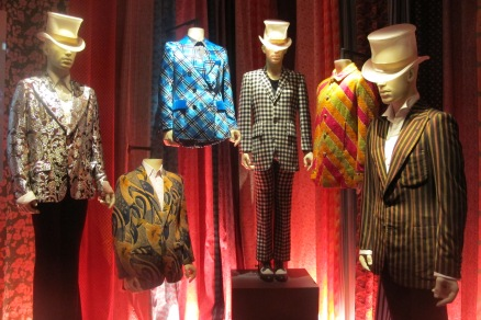 "Far right: Mick's striped suit that can be seen in a few '73 press conference pics and magazine spreads while the Stones toured Europe in '73; In the middle is the black and white checked suit Mick wore often during the '69 tour and trip to America; it pops up in several Ethan Russell photos of the Stones staying at Stephen Stills' house in Laurel Canyon in L.A. while preparing for the U.S. tour, as well as a dress rehearsal for the ""Ed Sullivan Show"" that fall (where they performed ""Gimme Shelter"" and ""Love In Vain"")"
