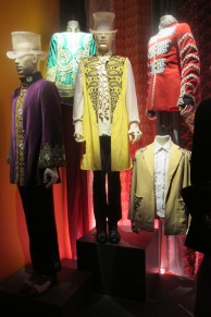 Jagger's Jumpin' Jack Flash yellow embroidered blazer used in the alternate version (no warpaint/makeup etc.) promo for the single, backed by an assortment of Carnaby Street/Granny Takes A Trip Edwardian/Victorian wear from the mid-60s (you can spot these items in many 1966-68 photos of the band, and the band wore them onstage for concert appearances as well)